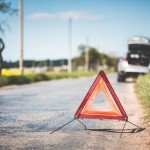 red-warning-triangle-and-broken-car-at-the-side-of-the-road-picjumbo-com